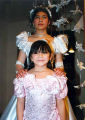 Quinceañera of Cecilia shown posing with her sister Rubi, Olympic Peninsula, 1995