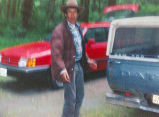Don Jose in the woods with his pickup truck, probably on the Olympic Peninsula, ca. 1990