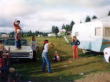 Family party with a piñata near the Velasquez trailer, probably on the Olympic Peninsula, ca. 2000