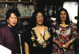 Las Tres Doñas singing inside a room, probably on the Olympic Peninsula, 1999
