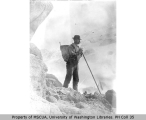 H. M. Sarvant with climbing equipment on the South Mowich Glacier, northwest slope of Mount...
