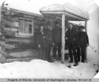 Five miners in front of cabin, probably Yukon Territory, March 5, 1901