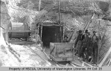 Four miners at entrance to Magaw and Andrews mine shaft, Cheechako Hill, 1899