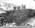 Eight miners working on mining dump, Hunker Creek, 1899