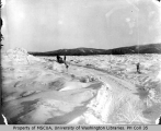 Horse-drawn sled freighting to Dawson over ice at mouth of Stewart River, April 9, 1900