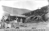 Mining operation showing rockers and cabin on Adams Hill, 1899