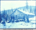 Men and dogsleds in front of 54 Roadhouse, Hunker Creek, 1899