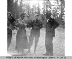 Three woman and a man at Longmire Springs, Mount Rainier, showing one woman wearing a pair of...