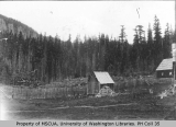 Two buildings and Mount Rainier at Longmire Springs, ca. 1897