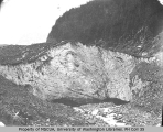 Carbon River running rising out of the Carbon Glacier, north slope of Mount Rainier, July 18, 1897