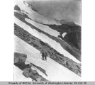 Hikers on snow covered slope, Mount Rainier, July 23, 1910