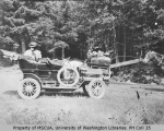 Mrs. H. M. Sarvant in automobile on a road trip to Mount Rainier, August 14, 1908