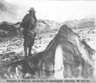 P. V. Caesar with hiking equipment on White Glacier, west slope of Mount Rainier, July 22, 1910