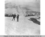 Two men, Plummer and Holmes, on a snow slope in Paradise Park, Mount Rainier, August 1896