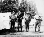 Group of four men with climbing equipment at Reese's Camp, Paradise Park, July 25, 1910