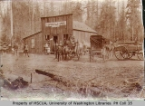 Horses and wagons in front of the Huntersville Store on Eatonville Road, ca. 1895