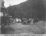 Automobiles and tents staked outside of lodge or hotel, vicnity of Mount Rainier, 1909