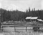 Longmire Hotel showing the southeast slope of Mount Rainier in background, Longmire Springs, ca....
