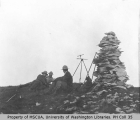 Men resting next to surveyor's equipment, Mount Rainier, ca. 1910