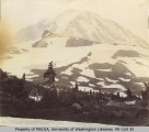 Campsite in Spray Park with Mount Rainier in background, ca. 1896