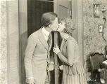 "A scene from ""Be a Little Sport,"" with Albert Ray and Elinor Fair."