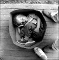 Boy asleep in cardboard box, Hooverville, ca. 1933