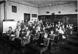 Interior of classroom showing school children seated at desks, n.d.