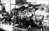 Vegetable vendors and horse-drawn wagons at the Pike Place Market, n.d.