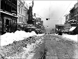 1st Ave. vicnity of Pike St. after a snowfall, 1916