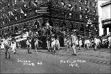 Seattle Potlatch Parade showing float drawn by people dressed as frogs, 1912