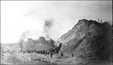 Cutting into the hill at 4th Ave. and Pine St. using steam shovel during the Denny Hill regrade,...