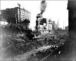 Regrading on 3rd Ave showing steam shovel at work, ca. 1907