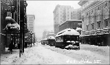 Streetcars on Pike St. showing aftermath of snow storm, 1916