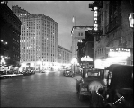 Corner of 5th Ave., Olive Way and Westlake Ave. at night, n.d.
