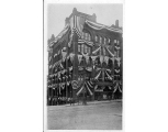Haller Building decorated for celebration with flags at the northwest corner of 2nd Ave. and...