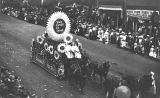 Golden Potlatch parade showing the Standard Furniture Company float, 1912