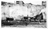 Regrading activities showing steam shovel and railroad hauling dirt, Seattle, 1909