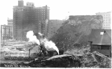 Denny Hill regrade work with steam shovels showing the New Hotel Washington at 2nd Ave. and...