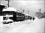 Electric streetcars in Queen Anne district on 1st Ave. N. and Harrison St. after a snowfall, ca....
