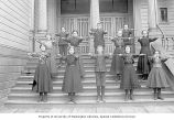 Eighth grade class standing on steps of the Denny School, Seattle, April 26, 1899