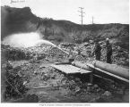Sluicing water with hydraulic giant at excavation site, Denny Hill Regrade, June 6, 1906