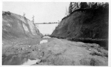 Footbridge over large cut, possibly the Montlake Cut, Seattle, n.d.