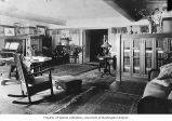 Charles H. Clarke residence showing living room interior, n.d.