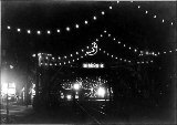 1st Ave. decorated at night, 1899