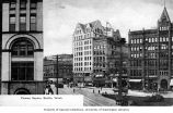 Pioneer Square showing the Pioneer Building (right) and the Lowman Building (center), ca. 1905