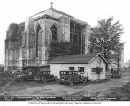 St. Mark's Episcopal Cathedral under construction showing cars parked around a shed, Seattle,...