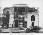 St. Mark's Episcopal Cathedral under construction, with cars parked in front, Seattle, Washington,...