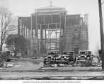 St. Mark's Episcopal Cathedral under first stage of construction, with five parked cars and wooden...