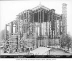 St. Mark's Episcopal Cathedral under construction with visible steel beam frame and wooden braces,...