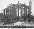St. Mark's Episcopal Cathedral under construction, with no roof and visible steel beam frame,...